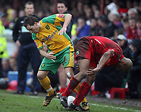 Photo: Rich Eaton.<br /> <br /> Tamworth FC v Norwich City. The FA Cup. 06/01/2007. Darren Huckerby left of Norwich and Tamworths Adie Smith go for the ball