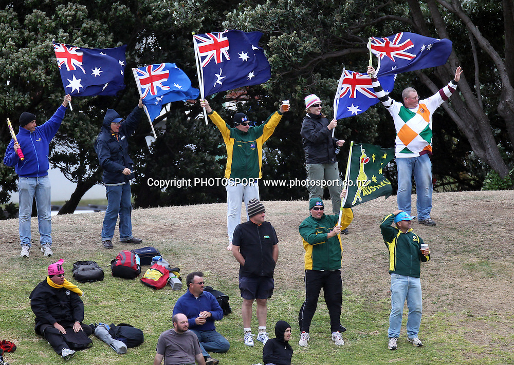 Australian fans brave the wind and the elements.<br />