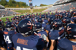 UVA huddles before the ECU game.  The Virginia Cavaliers defeated the East Carolina Pirates 35-20 in NCAA football at Scott Stadium on the Grounds of the University of Virginia in Charlottesville, VA on October 11, 2008.