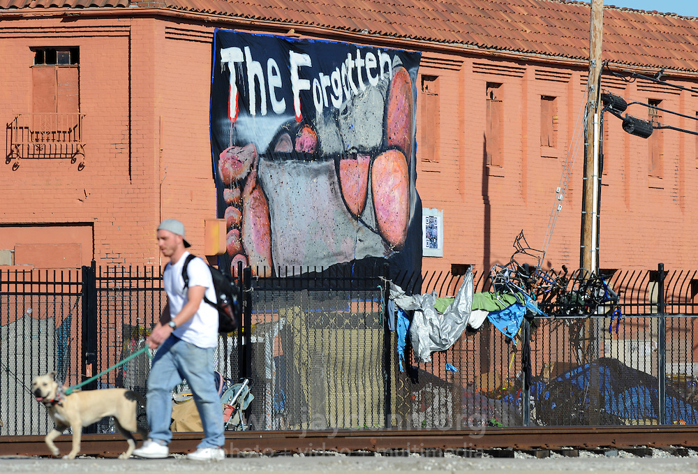 """Seen with a long lens from Pajaro Street and Market in Salinas, """"The Forgotten"""" is at least thirty feet long and was installed by art group C3 using a scissor jack. Homelessness in Salinas remains an intractable problem."""