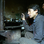 For the illegal coal miners their accommodation in very poor and lacks of basic standards. The workers co-habit in one room. Yushe Coal Mine, Laoying Mountains, China.