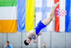 Rok Klavora of Slovenia competes in the Floor Exercise during Qualifiying day  of Artistic Gymnastics World Challenge Cup Ljubljana, on April 18, 2014 in Hala Tivoli, Ljubljana, Slovenia. Photo by Vid Ponikvar / Sportida