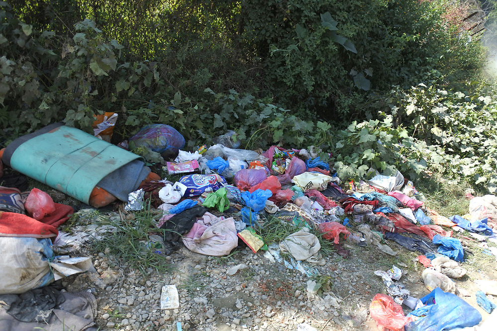 Fly tipping of rubbish all kinds in a country lane, Kathmandu, Nepal