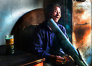 A man enjoys a smoke in a tea hous in Jianshui, Yunnan, China.