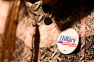 A supporter listens as U.S. Democratic Presidential candidate Senator Hillary Clinton (D-NY) gives a speech during a campaign stop in Ames, Iowa October 24 2007.