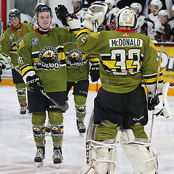 "TRENTON, ON  - MAY 4,  2017: Canadian Junior Hockey League, Central Canadian Jr. ""A"" Championship. The Dudley Hewitt Cup Game 5 between Powassan Voodoos and the Georgetown Raiders.    Rhys Brown #16 of the Powassan Voodoos high fives  Nate McDonald #33 of the Powassan Voodoos during the second period<br /> (Photo by Alex D'Addese / OJHL Images)"