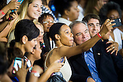 Senator Tim Kaine (D-VA) posed for photos with supporters after campaigning with Hillary Clinton, presumptive 2016 Democratic presidential nominee, at Northern Virginia Community College in Annandale, Va., U.S., on Thursday, July 14, 2016. Clinton and the former Virginia Governor discussed their shared commitment to building an America that is stronger together, while emphasizing that Donald Trump's divisive agenda would be dangerous for America. Kaine is considered to be the frontrunner for the Vice Presidential slot. Photographer: Pete Marovich/Bloomberg