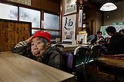 Kawasaki, November 21 2014 - Japanese artist Tatsumi ORIMOTO's 97-year-old mother having lunch in a noodle restaurant.
