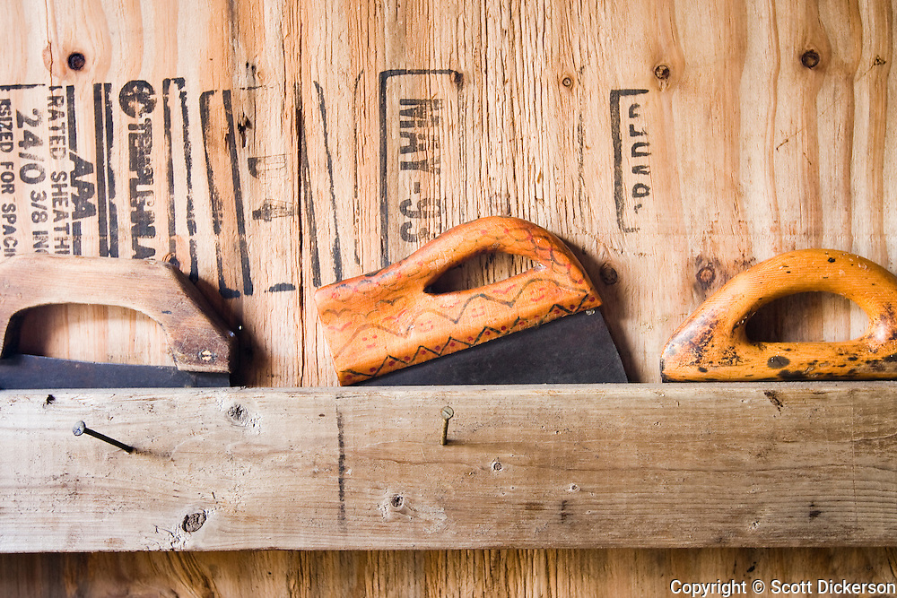 Ulu knives in a smoke house. These native Alaskan traditional tools are used for filleting and stripping subsistence salmon from Bristol Bay, Alaska.