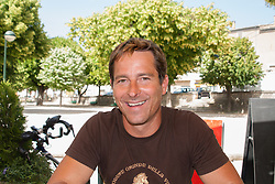 happy man sitting at a cafe in Southern France