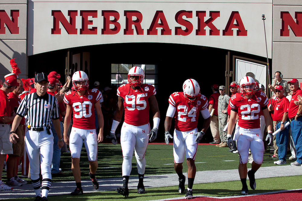 October 16, 2010: Nebraska Cornhuskers kicker Alex Henery #90, defensive end Pierre Allen #95, wide receiver Niles Paul #24, and running back Rex Burkhead #22 are lead out by a game official for the coin toss against Texas at Memorial Stadium in Lincoln, Nebraska. Texas defeated Nebraska 20 to 13.