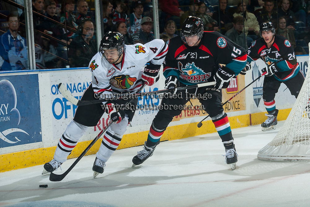 KELOWNA, CANADA - NOVEMBER 22: Tomas Soustal #15 of Kelowna Rockets checks Josh Hanson #4 of Portland Winterhawks during third period on November 22, 2014 at Prospera Place in Kelowna, British Columbia, Canada.  (Photo by Marissa Baecker/Shoot the Breeze)  *** Local Caption *** Tomas Soustal; Josh Hanson;