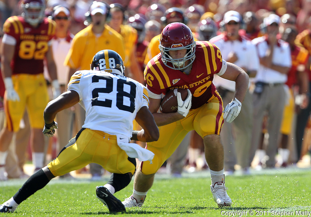 September 10, 2011: Iowa State Cyclones tight end Kurt Hammerschmidt (96) tries to avoid Iowa Hawkeyes defensive back Shaun Prater (28) after a catch during the first half of the game between the Iowa Hawkeyes and the Iowa State Cyclones during the Iowa Corn Growers Cy-Hawk game at Jack Trice Stadium in Ames, Iowa on Saturday, September 10, 2011. Iowa State defeated Iowa 44-41 in 3OT.