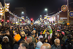 "© Licensed to London News Pictures. 01/11/2015. Leicester, UK. More than 35,000 people were estimated to have attended the annual Diwali ight switch-on which took place along the named ""Golden Mile"" in Belgrave Road, Leicester. Pictured, the massive crowd watch as the lights come on. Photo credit : Dave Warren/LNP"