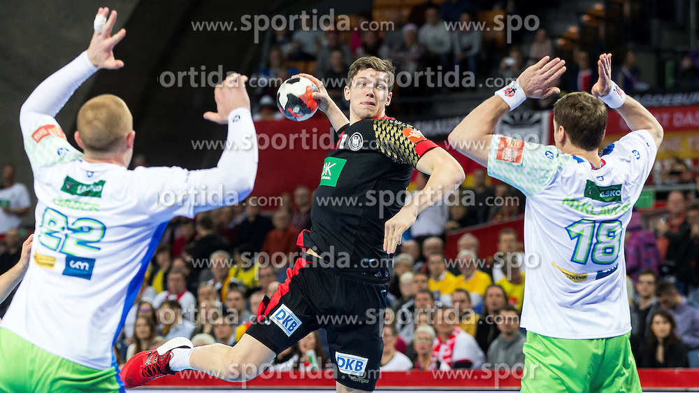 20.01.2016, Jahrhunderthalle, Breslau, POL, EHF Euro 2016, Deutschland vs Slowenien, Gruppe C, im Bild Christian Dissinger (Nr. 47, THW Kiel) steigt gegen Matej Gaber (Nr. 22, Montpellier AHB) und David Miklavcic (Nr. 18, Tremblay en France Handball) hoch // during the 2016 EHF Euro group C match between Germany and Slovenia at the Jahrhunderthalle in Breslau, Poland on 2016/01/20. EXPA Pictures &copy; 2016, PhotoCredit: EXPA/ Eibner-Pressefoto/ KOENIG<br /> <br /> *****ATTENTION - OUT of GER*****