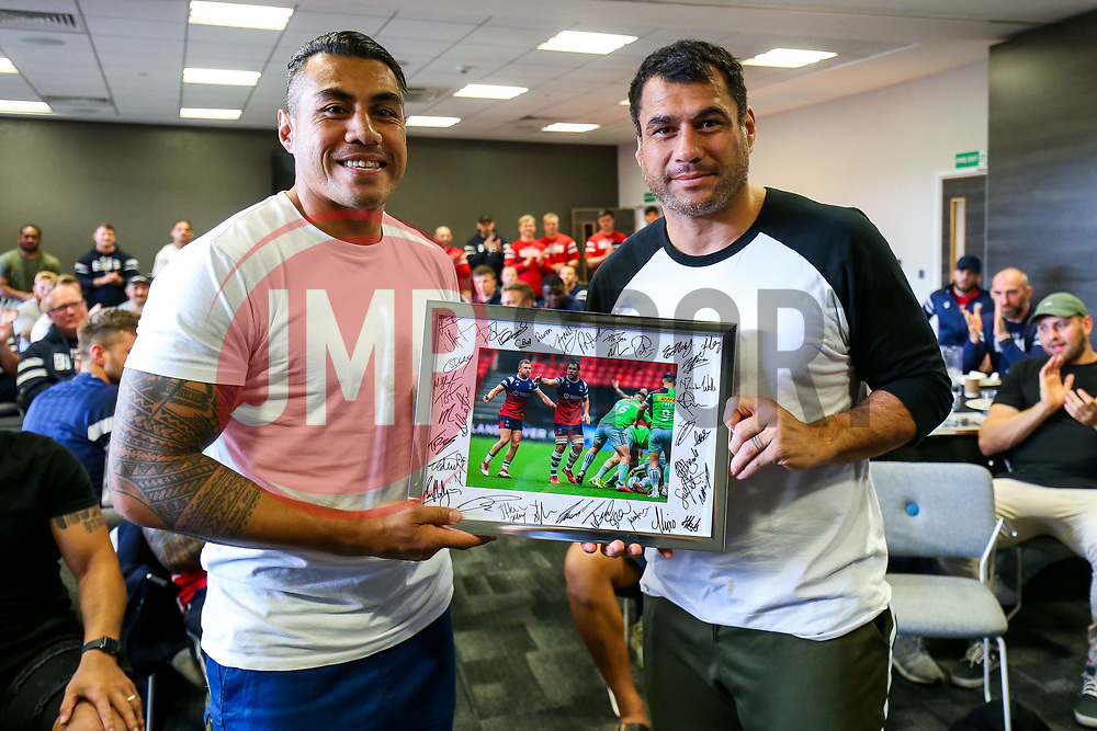 Tusi Pisi thanks George Smith as the Bristol Bears squad gather to make presentations to departing players after the Bristol Bears Team Run ahead of the Sale Sharks Game - Rogan/JMP - 02/05/2019 - RUGBY UNION - Ashton Gate Stadium - Bristol, England - Bristol Bears v Sale Sharks - Gallagher Premiership Rugby.