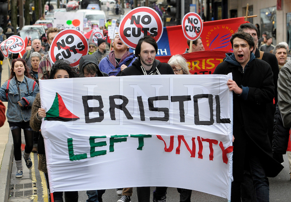 © Licensed to London News Pictures. 08/02/2014; Bristol, UK. <br /> Around 200 people demonstrate through the city centre against cuts by the Mayor of Bristol, George Ferguson, to Bristol City Council's local services, part of the Government's austerity programme cutting funding to local authorities, and against the bedroom tax. 08 February 2014.<br /> Photo credit: Simon Chapman/LNP