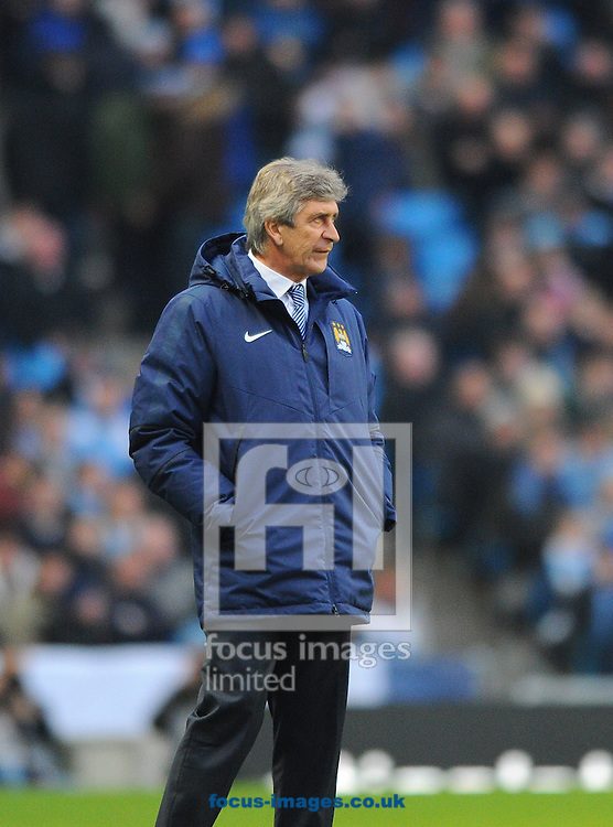 Manchester City manager Manuel Pellegrini during the Barclays Premier League match at the Etihad Stadium, Manchester<br /> Picture by Greg Kwasnik/Focus Images Ltd +44 7902 021456<br /> 07/02/2015