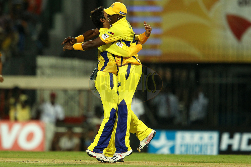 Suresh raina celebrates the wicket of Aiden Blizzard with Dwayne Bravo during match 3 of the NOKIA Champions League T20 ( CLT20 )between the Chennai Superkings and the Mumbai Indians held at the M. A. Chidambaram Stadium in Chennai , Tamil Nadu, India on the 24th September 2011..Photo by Ron Gaunt/BCCI/SPORTZPICS