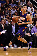 Feb 10, 2016; Phoenix, AZ, USA; Phoenix Suns guard Devin Booker (1) handles the ball during the game against the Golden State Warriors at Talking Stick Resort Arena. The Golden State Warriors won 112-104. Mandatory Credit: Jennifer Stewart-USA TODAY Sports