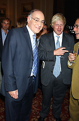 Left & centre, MICHAEL HOWARD and BORIS JOHNSON at a party to celebrate the publication o'Seventy Two Virgins' by Boris Johnson held at The Travellers Club, 106 Pall Mall, London on 14th September 2004.<br />