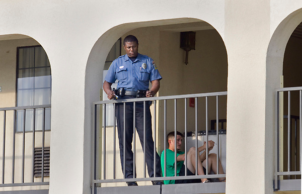 Vicksburg Police Officer Eric Paymon stands outside of room 202 at the Econo Lodge on East Clay Street on Monday, May 23, 2011 after responding to a shooting. (Bryant Hawkins/The Vicksburg Post)