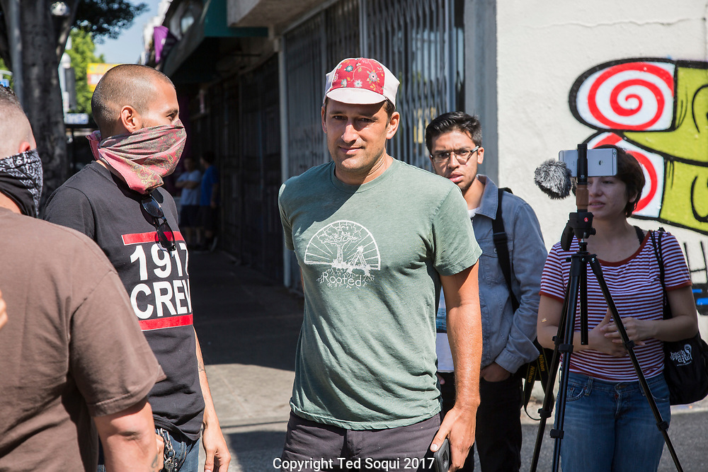 Joe Ali Bray leaving the coffee house.<br /> Boycott and demonstration against Weird Wave Coffee House on Caesar E. Chavez Ave in Boyle Heights. About 25 demonstrators held signs and chanted slogans out front of the coffee house.