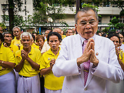04 DECEMBER 2012 - BANGKOK, THAILAND: People from across Thailand pray for the health of Bhumibol Adulyadej, the King of Thailand, in the courtyard at Siriraj Hospital in Bangkok. They were wearing yellow, the official color of the Thai King. The King celebrates his 85th birthday Wednesday, Dec. 5. The King lives in Siriraj. He is expected to make a rare public appearance and address the nation from Mukkhadej balcony of the Ananta Samakhom Throne Hall in the Royal Plaza. The last time he did so was in 2006. His birthday is a public holiday in Thailand and hundreds of thousands of people are expected to jam the streets around the Royal Plaza and Grand Palace to participate in the festivities.    PHOTO BY JACK KURTZ