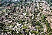 Nederland, Groningen, Hoogezand-Sappemeer, 27-08-2013;<br /> Zicht in westelijke richting. Noorderstraat loopt dwars door de woonwijken van Hoogezand-Sappemeer.   Willibrordkerk midden beneden. Winschoterdiep rechts.<br /> The village of Hoogezand-Sappemeer in the north of the Netherlands.<br /> Aan de horizon het platteland van Groningen.<br /> luchtfoto (toeslag op standaard tarieven);<br /> aerial photo (additional fee required);<br /> copyright foto/photo Siebe Swart.