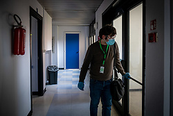 Milan - Coronavirus emergency. USCA Special Continuity Care Units. Dr. Lops visits a quarantined patient at home for being in contact with a positive. The unit is based in the San Carlo hospital