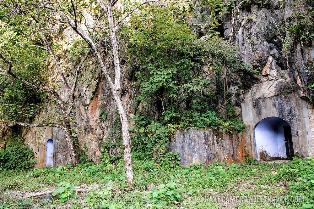 Entrance to the hospital caves at the Pathet Lao Caves of Vieng Xai in Houaphanh Province in northeastern Laos. It was in these natural caves deep in karsts that the Pathet Lao leadership avoided constant American bombing raids during the Vietnam War.