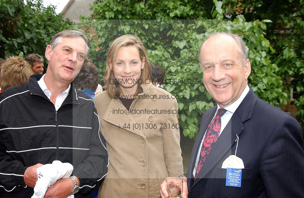 Left to right, LORD ASTOR OF HEVER, his daughter the HON.CAMILLA ASTOR and LORD COPE at the annual House of Lords v House of Commons tug of war match in aid of  of  Macmillan Cancer Relief on 22nd June 2004.  A drinks reception was held in College Gardens followd by the tug of war on Victoria Tower Gardens, London.