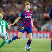 BARCELONA, SPAIN - August 25:  Frenkie de Jong #21 of Barcelona in action during the Barcelona V  Real Betis, La Liga regular season match at  Estadio Camp Nou on August 25th 2019 in Barcelona, Spain. (Photo by Tim Clayton/Corbis via Getty Images)