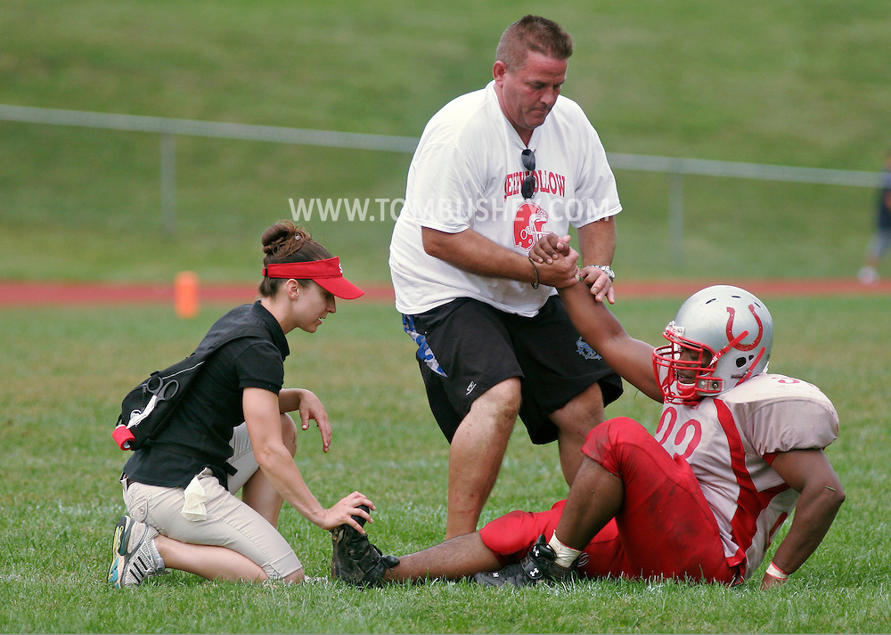Beacon, NY - A coach and an athletic trainer help a Sleepy Hollow High School football player who suffered from leg cramps during against Beacon on Sept. 13, 2008.