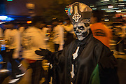 New York, NY, October 31, 2013. A man in a bishop's costume with a skull for a face in the Greenwich Village Halloween Parade.