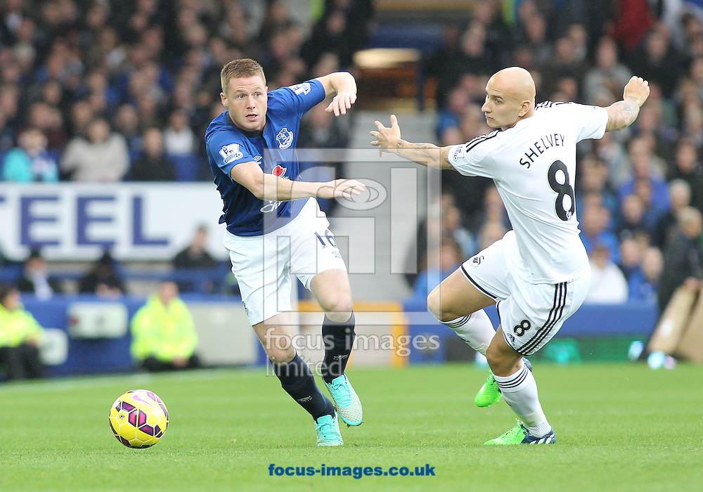 James McCarthy of Everton and Jonjo Shelvey of Swansea City in action during the Barclays Premier League match at Goodison Park, Liverpool.<br /> Picture by Michael Sedgwick/Focus Images Ltd +44 7900 363072<br /> 01/11/2014
