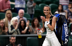 Magdalena Rybarikova reacts after beating Coco Vandeweghe on day eight of the Wimbledon Championships at The All England Lawn Tennis and Croquet Club, Wimbledon.