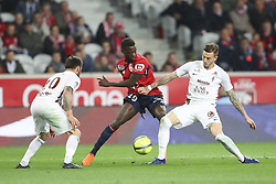 April 28, 2018 - Villeneuve D Ascq, France - Nicolas Pepe ( Lille )  vs Nolan Roux  (Credit Image: © Panoramic via ZUMA Press)