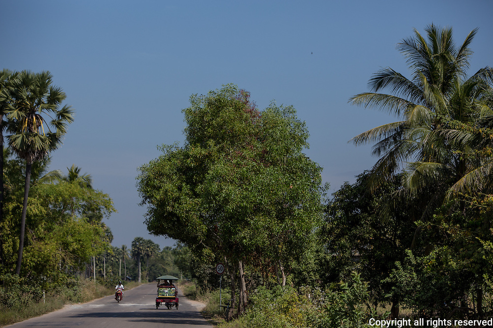 Taking a tuk tuk through the Cambodia countryside on the way to num ban chok makers in a village outside Siem Reap.