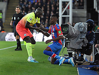Football - 2019 / 2020 Premier League - Crystal Palace vs. Manchester City<br /> <br /> Wilfried Zaha of Palace is helped to his feet by Benjamin Mendy after being puled into touch, at Selhurst Park.<br /> <br /> COLORSPORT/ANDREW COWIE