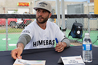 KELOWNA, CANADA - JUNE 28: Former NHL player Brian Gionta sits at an autograph table during the opening charity game of the Home Base Slo-Pitch Tournament fundraiser for the Kelowna General Hospital Foundation JoeAnna's House on June 28, 2019 at Elk's Stadium in Kelowna, British Columbia, Canada.  (Photo by Marissa Baecker/Shoot the Breeze)