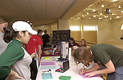 15782         Assistant Fitness Manager and Sophomore Julie Dischinger records measurements for a Fitness evaluation for Freshman Aslyne Rodriguez during the 12th annual Ohio University Health & Wellness fair.