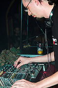 A disk jockey playing music at a nightclub