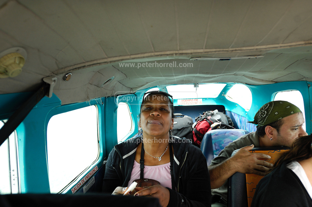 Ecuador, May 5 2010: Lorna Brooks and Jorge in airplane flying into Huaorani territory. Copyright 2010 Peter Horrell
