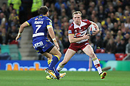 Dan Sarginson of Wigan Warriors and Tyrone Roberts of Warrington Wolves in action during the Betfred Super League Grand Final at Old Trafford, Manchester.<br /> Picture by Michael Sedgwick/Focus Images Ltd +44 7900 363072<br /> 13/10/2018