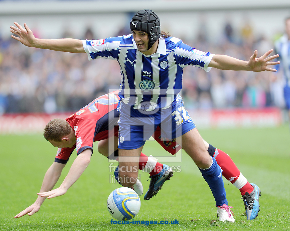 Picture by Graham Crowther/Focus Images Ltd. 07763140036.05/05/12.Miguel Llera of Sheffield Wednesday denies Stuart Beavon of Wycombe Wanderers during the Npower League 1 game at Hillsborough stadium, Sheffield.