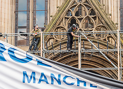 Work underway to fix the main banner outside the town hall at National Olympic Heroes Parade in<br /> Manchester<br /> <br /> (c) John Baguley | Edinburgh Elite media
