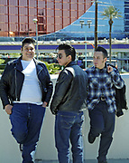 3 young rockabillies boys in jeans and leather jackets, Viva Las Vegas Festival, Las Vegas, USA 2006.