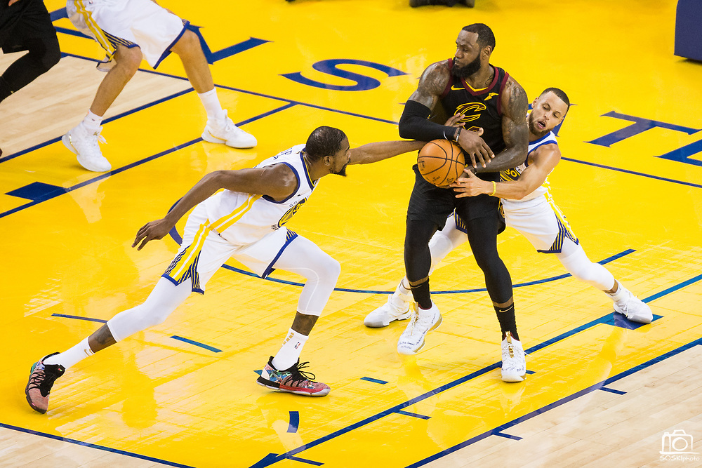 Golden State Warriors forward Kevin Durant (35) and Golden State Warriors guard Stephen Curry (30) double team Cleveland Cavaliers forward LeBron James (23) during Game 1 of the NBA Finals at Oracle Arena in Oakland, Calif., on May 31, 2018. (Stan Olszewski/Special to S.F. Examiner)