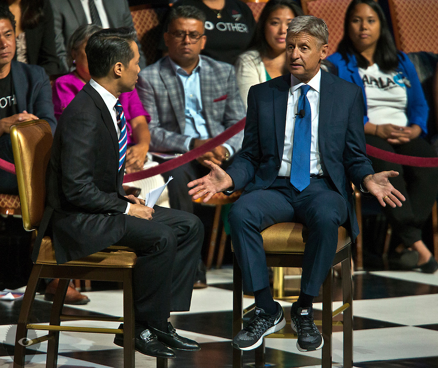New Mexico Gov. Gary Johnson (right) as the Libertarian Party presidential nominee, speaks while interviewed by Richard Lui during a presidential election forum at The Colosseum at Caesars Palace on Friday, August 12, 2016.
